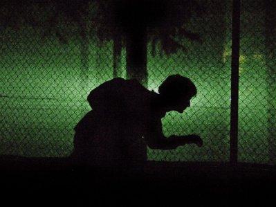 conspiracy-man-sneaking-around-in-the-dark-creepy