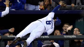 The Moose is loose: Mike Moustakas continues his storybook playoff run with an incredible catch into the stands at Kauffman Stadium in Kansas City.